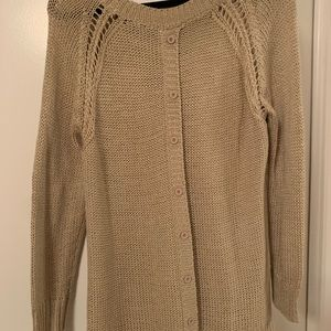 Tan colored sweater with buttons down the back